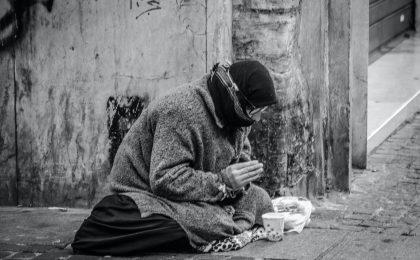 poor person praying